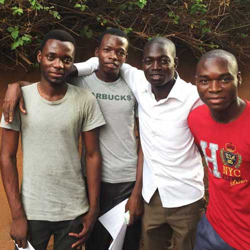 Isaac, Michel, Francis & Albert are Espoir Jeunes alumni. Now enrolled at Ouagadougu University they act as mentors to the children in Gaoua